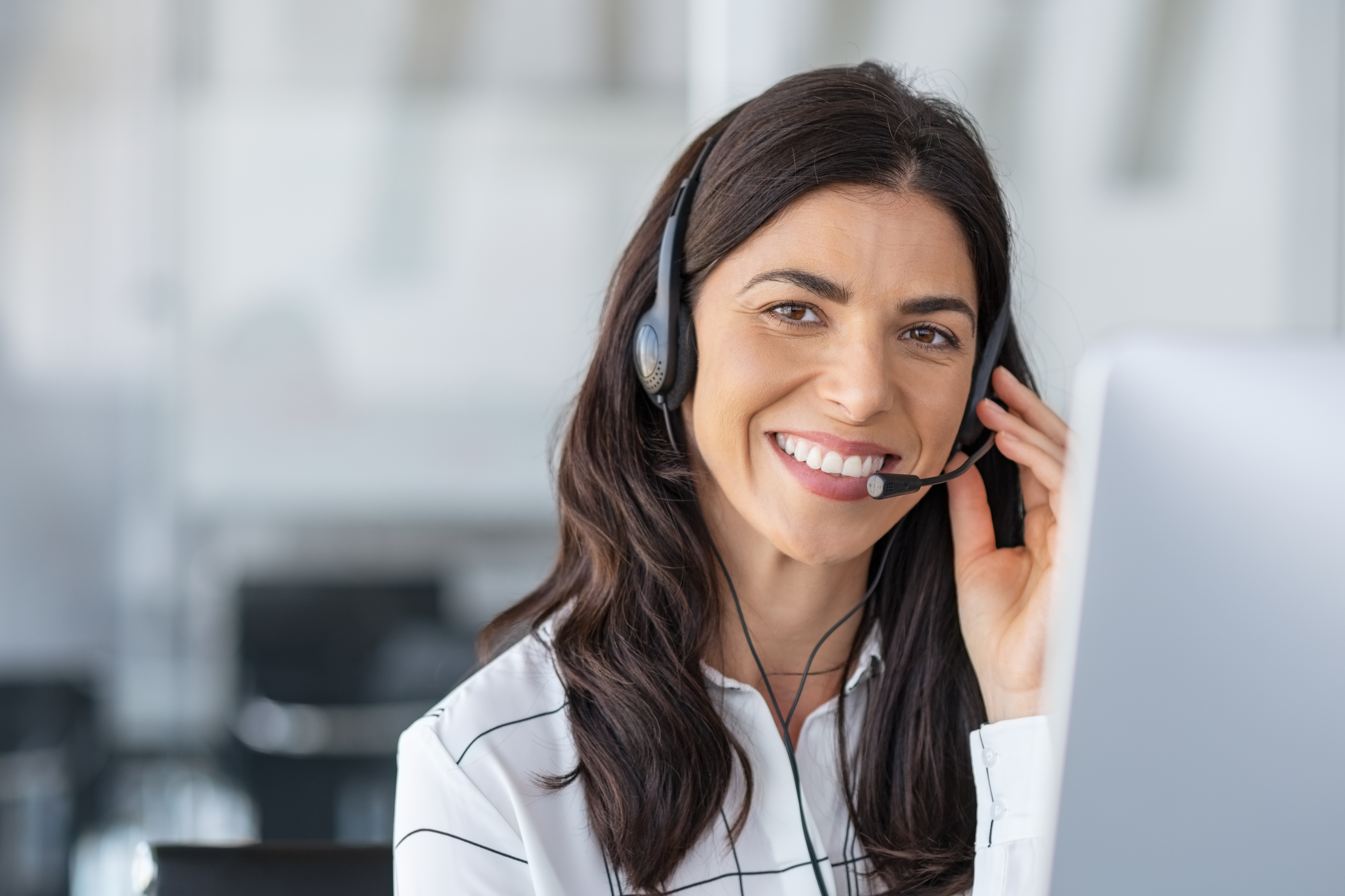 bigstock-Call-center-agent-with-headset-343674517